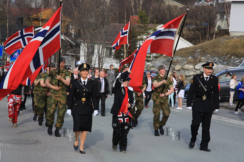 Police officers march in official parade celebrating Constitution Day and nation's independence on May 17th in Kirkenes, Norway.