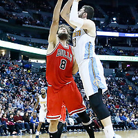 22 November 2016: Denver Nuggets center Jusuf Nurkic (23) takes a jump shot over Chicago Bulls center Robin Lopez (8) during the Denver Nuggets 110-107 victory over the Chicago Bulls, at the Pepsi Center, Denver, Colorado, USA.