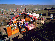 The Regzen family outside their ger with all of their possessions, Ulaanbaatar, Mongolia. Published in Material World pages 40-41. The Regzen Batsuuri family lives in a 200 square foot ger (round tent built from canvas, strong poles, and wool felt) on a hillside lot overlooking one of the sprawling valleys that make up Ulaanbaatar, Mongolia.