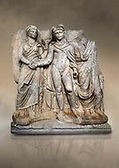 """Roman Sebasteion releif sculpture of emperor Claudius and Agrippina, Aphrodisias Museum, Aphrodisias, Turkey.  Against an art background.<br /> <br /> Claudius in heroic nudity and military cloak shakes hands with his wife Agrippina and is crowned by the Roman people or the Senate wearing a toga. The subject is imperial concord with the traditional Roman state. Agrippina holds ears of wheat: like Demeter goddess of fertility. The emperor is crowned with an oak wreath, the Corona civica or """"citizen crow"""", awarded to Roman leaders for saving citizens lives: the emperor id therefore represented as saviour of the people. .<br /> <br /> If you prefer to buy from our ALAMY STOCK LIBRARY page at https://www.alamy.com/portfolio/paul-williams-funkystock/greco-roman-sculptures.html . Type -    Aphrodisias     - into LOWER SEARCH WITHIN GALLERY box - Refine search by adding a subject, place, background colour, museum etc.<br /> <br /> Visit our ROMAN WORLD PHOTO COLLECTIONS for more photos to download or buy as wall art prints https://funkystock.photoshelter.com/gallery-collection/The-Romans-Art-Artefacts-Antiquities-Historic-Sites-Pictures-Images/C0000r2uLJJo9_s0"""