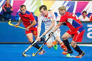 The Netherlands Seve Van Ass is tackled by Igor Siniagin of Russia. Russia v The Netherlands - Unibet EuroHockey Championships, Lee Valley Hockey & Tennis Centre, London, UK on 25 August 2015. Photo: Simon Parker