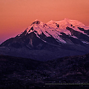 The majestic Illimani mountain with a height of 6439 meters forms part of the Cordillera Real of the Andes. La Paz, Bolivia.