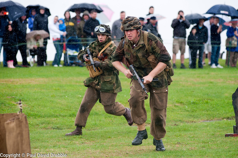 Sunday 19th August 2012 Lytham Saint Annes. Reenactors portray members of the 6th Airborne Division during the Northern World War Two Association (NWW2A) battle reenactment on Sunday which drew quite a crowd of spectators despite the downpour...19 August 2012.Image © Paul David Drabble