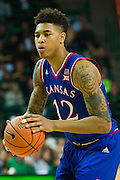 WACO, TX - JANUARY 7: Kelly Oubre Jr. #12 of the Kansas Jayhawks shoots a free-throw against the Baylor Bears on January 7, 2015 at the Ferrell Center in Waco, Texas.  (Photo by Cooper Neill/Getty Images) *** Local Caption *** Kelly Oubre Jr.