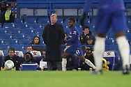 AFC Wimbledon manager Wally Downes watching from the touchline, in the dugout during the EFL Trophy match between U21 Chelsea and AFC Wimbledon at Stamford Bridge, London, England on 4 December 2018.