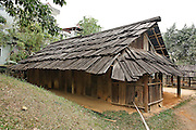 This house was built in 1984 by father of the last owner, Mr. Thao Phang Khay (born in 1972), of De Cho Chua A village, Pung Luong commune, Mu Cang Chai district, Yen Bai province. This was the home of a family of four. Hmong houses are built of wood, directly on the ground. For the flower Hmong of Mu Cang Chai, the wood must be that of the po mu tree (visible growing behind this house). House-building is men's work. Only axes and knives are used as tools, and all of the pieces are lashed together. This house was reconstructed at the museum in six days in 1999, by a group of seven Hmong villagers.