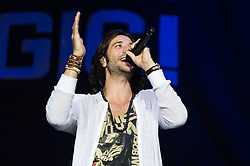 "© Licensed to London News Pictures. 26/05/2015. London, UK.   Magic performing live at Wembley Arena, supporting headliner Maroon 5.   In this picture - Nasri.  Magic! Is a Canadian reggae fusion band,  composed of songwriter and record producer Nasri (lead vocals, Guitar), Mark Pellizzer (guitar, vocals), Alex Tanas (drums) and Ben Spivak (bass, vocals).  They are most well-known for their debut single, ""Rude"", which peaked at number-one in seven countries.  Photo credit : Richard Isaac/LNP"