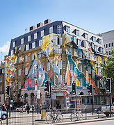 """""""Marmite"""" a graffiti mural painted on the classical facade of Megaro Hotel opposite St Pancras station, London, 2012. The mural was designed and painted by four members of street art collective, Agents of Change."""