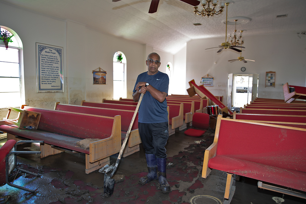 Rev. Haywood Johnson Jr., pastor of the Saint Paul Missionary Baptist Church, inside his church to check on the damage for the first time since returning to the town after evacuating before Hurricane Ida hit.