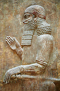 Stone relief sculptured panel of a dignitary . Facade L. Inv AO 19875 from Dur Sharrukin the palace of Assyrian king Sargon II at Khorsabad, 713-706 BC.  Louvre Museum Room 4 , Paris .<br /> <br /> If you prefer to buy from our ALAMY PHOTO LIBRARY  Collection visit : https://www.alamy.com/portfolio/paul-williams-funkystock/ancient-assyria-antiquities.html  Refine search by adding background colour, place, subject, museum etc into the LOWER SEARCH WITHIN GALLERY box to <br /> <br /> Visit our ANCIENT WORLD PHOTO COLLECTIONS for more photos to download or buy as wall art prints https://funkystock.photoshelter.com/gallery-collection/Ancient-World-Art-Antiquities-Historic-Sites-Pictures-Images-of/C00006u26yqSkDOM