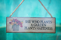 Sign hanging in greenhouse