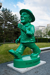 Statue of famous Ampelmann in Berlin Germany. This green light figure used on pedestrian crossings to show safe to cross street.