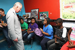 The Prince of Wales, during a visit to the Youth Empowerment Project in The British Virgin Islands, where he was given a guided tour of the centre and viewed damage caused by the storm and demonstrations from children of the activities provided by the project, as he continues his tour of hurricane-ravaged Caribbean islands.