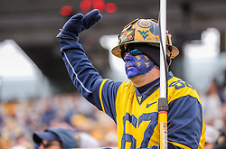 Nov 23, 2019; Morgantown, WV, USA; A West Virginia Mountaineers fan cheers during the third quarter against the Oklahoma State Cowboys at Mountaineer Field at Milan Puskar Stadium. Mandatory Credit: Ben Queen-USA TODAY Sports