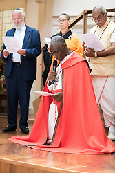 """23 July 2018, Amsterdam, the Netherlands: Rev. Canon Gideon Byamugisha, a founder of the International Network of Religious Leaders Living with or Personally Affected by HIV or AIDS (INERELA+), kneels in a concluding word of prayer. Gathered in a """"common voice"""" religious leaders from a multitude of religions """"urgently demand that the world recommit to ending AIDS and that world leaders take strong action to ensure this epidemic is finally brought to an end."""" On 23 July, an international Interfaith Memorial and Prayer Service takes place in the Keizersgrachtkerk in Amsterdam, the Netherlands. Gathering local congregants together with international guests, the service takes place in connection with the 2018 International AIDS Conference, held in Amsterdam on 23-27 July."""
