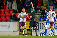 Christophe Berra (#6) of Heart of Midlothian FC can't believe he's been shown a yellow card by referee David Munro during the Ladbrokes Scottish Premiership match between St Johnstone FC and Heart of Midlothian FC at McDiarmid Park, Perth, Scotland on 30 October 2019.