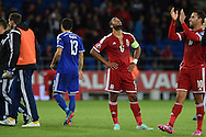 Wales captain Ashley Williams shows his relief as the match ends 0-0.  Euro 2016 qualifying group B match, Wales v Bosnia- Herzegovina at the Cardiff city Stadium in Cardiff, South Wales on Friday 10th Oct 2014.<br /> pic by Andrew Orchard, Andrew Orchard sports photography.