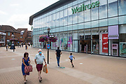 Shoppers pass a branch of Waitrose on 14th July 2021 in Windsor, United Kingdom. John Lewis and Waitrose have announced plans to cut 1,000 jobs as part of a shake-up of store management to follow the closure of eight John Lewis stores earlier this year.