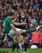 09.02.2013 Edinburgh, Scotland.     Ireland's Connor Murray see's his kick charged down by Scotland's Kelly Brown during the RBS Six Nations Championship match between Scotland and Ireland, from Murrayfield Stadium.