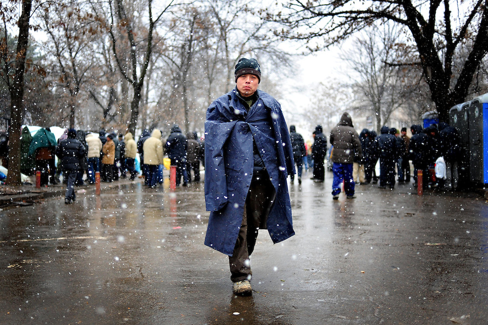A chinese citizen is walking alongside the Chinese Embassy in Bucharest. A few hundred chinese citizens erected tents in front of the Chinese Embassy building after they were fired by the romanian companies where they were working
