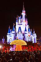 Alice in Wonderland, Disney's Electrical Parade (with Cinderella Castle in back), Magic Kingdom, Walt Disney World, Orlando, Florida USA