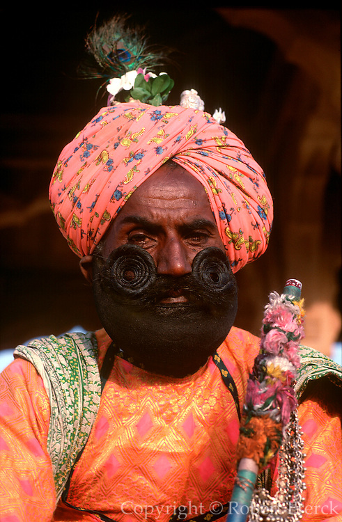 INDIA, ARTS and MUSIC traditional musician with huge mustache playing music in Jaisalmer, Rajasthan