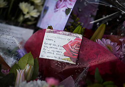 """© Licensed to London News Pictures. 04/04/2018. London, UK. A note on flowers reading """"Rest up Sis"""", left on Chalgrove Road, Tottenham, north London, the scene where 17 year old Tanesha Melbourne, was shot dead on Monday. A recent spree of killings in the capital has taken the murder toll for the year so far to 48. Photo credit: Ben Cawthra/LNP"""