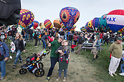 Colby, Brittany and Carter Sundgren use a selfie-stick at the AARP Block Party at the Albuquerque International Balloon Fiesta in Albuquerque New Mexico USA on Oct. 7th, 2018.