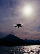 National Park Service and Office of Aircraft Services' de Havilland DHC2 Beaver on amphibious floats taking off from Hardenburg Bay, Port Alsworth, Lake Clark National Park and Preserve, Alaska.
