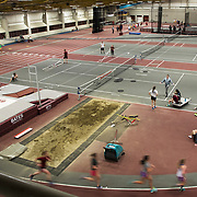 The men's and women's track and field team is seen practicing inside of Merrill Gymnasium.