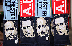 Scarves featuring Manchester City manager Pep Guardiola and Arsenal manager Unai Emery on sale outside the ground