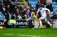 Levi Sutton of Scunthorpe United (22) escapes Jordan Shipley of Coventry City (26) during the EFL Sky Bet League 1 match between Scunthorpe United and Coventry City at Glanford Park, Scunthorpe, England on 5 January 2019.