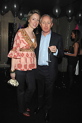 SIMON & REBECCA BREWER at a party to celebrate the 1st birthday of nightclub Kitts, 7-12 Sloane Square, London on 5th March 2008.<br />