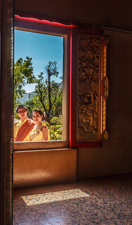 A wedding couple at Wat Chalong temple in Phuket, Thailand.