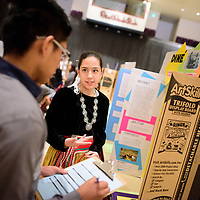 Devin Fatt, left, listen as Lillian Campbell of <br /> Lukachukai Community School describes her project on Dinè Ovens: Cooking With Wood during the 2018 Navajo Nation Science Fair at Red Rock Park Thursday.