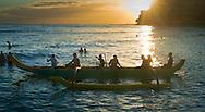Tourists on an outrigger canoe at sunset, Waikiki Beach, Honolulu, Oahu, Hawaii