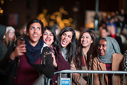 © Licensed to London News Pictures . 31/12/2015 . Manchester , UK . Thousands of people turn out in freezing temperatures to watch as Manchester celebrates the start of the New Year with a fireworks display in front of the Town Hall in Albert Square . Photo credit : Joel Goodman/LNP