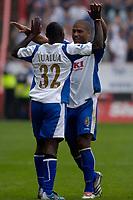 Photo: Daniel Hambury.<br />Charlton Athletic v Portsmouth. The Barclays Premiership. 16/09/2006.<br />Portsmouth's Lomana LuaLua celebrates his goal with Glen Johnson (R).