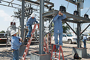 Western Farmers Electric Coop linemen working to upgrade a substation south of Norman from 69,000 volts to 138,000 volts.