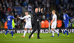 Burnley manager Sean Dyche applauds the fans after the final whistle of the Premier League match at the King Power Stadium, Leicester.