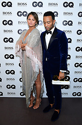 John Legend in the press room with the Hugo Boss Most Stylish Man Award alongside wife Chrissy Teigen at the GQ Men of the Year Awards 2018 in Association with Hugo Boss held at The Tate Modern in London.