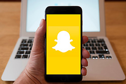 Using iPhone smart phone to display website logo of Snapchat social media app