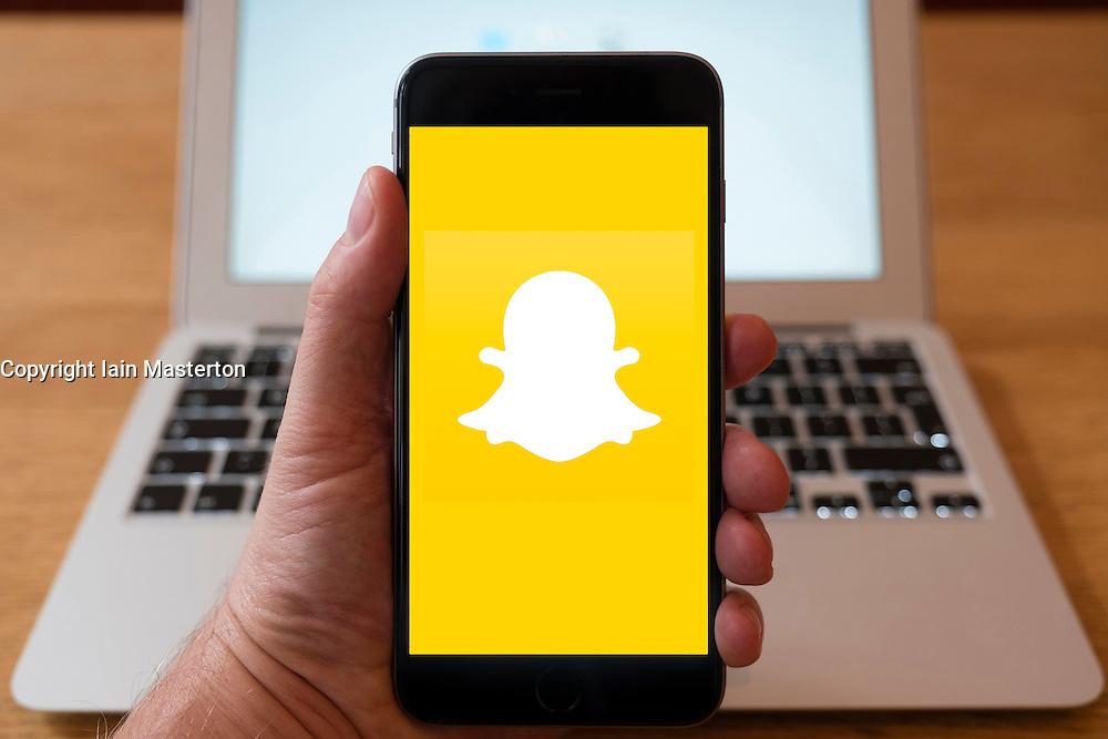 Using iPhone smart phone to display website logo of Snapchat social media app