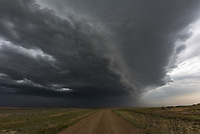 This shelf cloud first blew over me outside of Jordan, Montana. It was very dusty and windy.