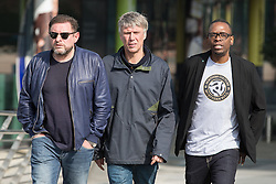 © Licensed to London News Pictures . 19/03/2015 . Salford Quays , UK . Shaun Ryder , Mark Berry ( Bez ) and Paul Leveridge ( Kermit ) . Black Grape photocall at The Green , Salford Quays , Greater Manchester . Black Grape are reforming for a Madchester charity gig along with other local bands , to raise awareness for Bez's Reality Party and anti-fracking . Photo credit : Joel Goodman/LNP