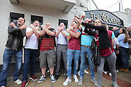 West Ham fans posing with Irons outside The Queens pub before k/o. scenes around the Boleyn Ground, Upton Park in East London as West Ham United play their last ever game at the famous ground before their move to the Olympic Stadium next season. Barclays Premier league match, West Ham Utd v Man Utd at the Boleyn Ground in London on Tuesday 10th May 2016.<br /> pic by John Patrick Fletcher, Andrew Orchard sports photography.