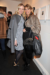 Left to right, NADYA ABELA and ASSIA WEBSTER at a Private View of Bruno Bisang 30 Years of Polaroids held at The Little Black Gallery, 13A Park Walk, London SW10 on 15th January 2013.