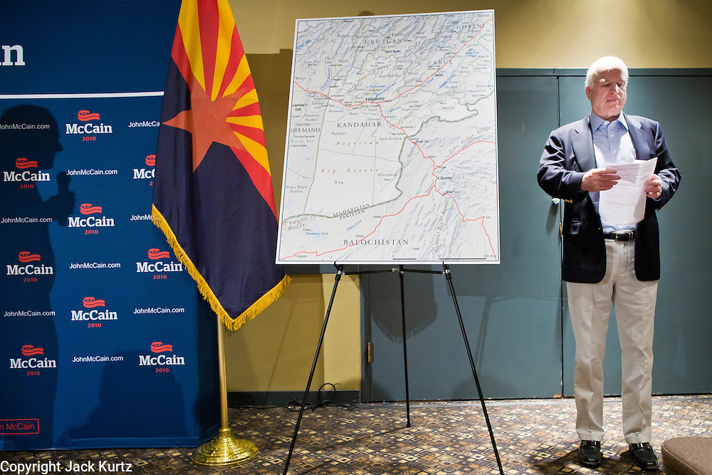 """July 10, 2010 - PHOENIX, AZ: US Senator JOHN MCCAIN (R-AZ) waits to speak at a town hall meeting in Phoenix. Sen. McCain held a """"town hall"""" meeting at a hotel in Phoenix Saturday morning. He criticized the Obama administration's handling of the war in Afghanistan, specifically the July 2011 date for the beginning of the withdrawl of US forces, the administration's handling of the immigration and border security issue and the recently passed health care reform bill, which he called """"Obamacare."""" McCain is in a primary battle with former Congressman JD Hayworth, he did not mention Hayworth, by name during the meeting.   Photo by Jack Kurtz"""