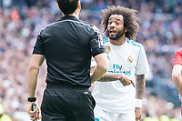 Real Madrid Marcelo  talking with the referee during La Liga match between Real Madrid and Atletico de Madrid at Santiago Bernabeu Stadium in Madrid, Spain. April 08, 2018. (ALTERPHOTOS/Borja B.Hojas)