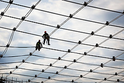 Workers constructing cable net roofing in the Velodrome of the Olympic Park. Photo taken on 15th March 2010 by Anthony Charlton.